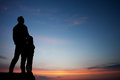 Father and son in sunset sky Royalty Free Stock Photo