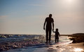 Father son to sea sunset image has attached release Royalty Free Stock Photography