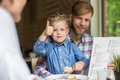 Father and son together in cafe family father s day indoor portrait Stock Image