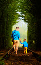 Father and son together in green tunnel railway Stock Images