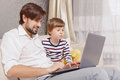 Father and son use computer Royalty Free Stock Photo