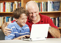 Father and Son Use Netbook Computer Stock Photo