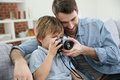 Father and son using a camera Royalty Free Stock Photo