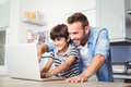 Father and son using laptop Royalty Free Stock Photo