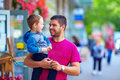 Father and son walking the crowded street candid image of Stock Images