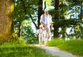 Father and son walking the forest sunlit path happy Royalty Free Stock Images