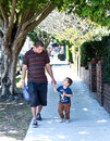Father and son walking outdoors happy Royalty Free Stock Image