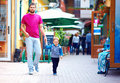 Father and son walking the street candid image of Stock Images