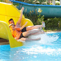 Father with the son on waterslide Royalty Free Stock Images
