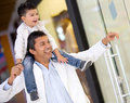 Father son window shopping mall looking happy Stock Images