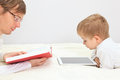 Father and son working from home wtih the book with touch pad Royalty Free Stock Photos