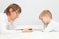 Father and son working from home wtih the book with touch pad Royalty Free Stock Image
