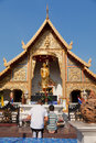 Father and son worshiping buddha chiang mai thailand march in front of a small temple in chiang mai Royalty Free Stock Photos