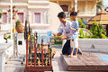 Father and son worshiping buddha chiang mai thailand march in front of a small temple in chiang mai Stock Photography