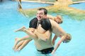Father and sons having fun in swimming pool Royalty Free Stock Photo