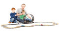 Father and sons playing kids racing toy car game Royalty Free Stock Image