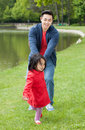 Father spends his free time with her daughter in the park Royalty Free Stock Photo