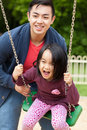 Father spends time with his cute daughter on the playground Royalty Free Stock Photo