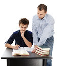 Father standing near son s desk helping him doing his homework studio shot of a isolated over white background Royalty Free Stock Photography