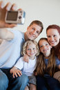 Father taking family picture with digi cam Royalty Free Stock Photo