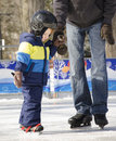 A father teaching his son how to ice skate Royalty Free Stock Photo