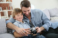 Father teaching his son son using a camera Royalty Free Stock Photo