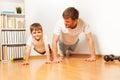 Father teaching kid son doing push-ups exercises Royalty Free Stock Photo