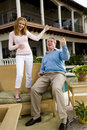Father and teen daughter playing air guitar Royalty Free Stock Photography
