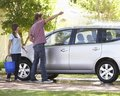 Father and teenage daughter washing car together Royalty Free Stock Photos