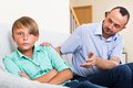 Father and teenage son argue ordinary in the middle of at a home Stock Photos