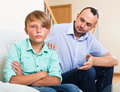Father and teenage son argue ordinary in the middle of in the home Royalty Free Stock Photography