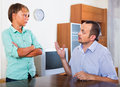 Father and teenage son argue ordinary in the middle of at the room in home Royalty Free Stock Images