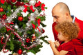 Father and toddler girl decorate tree christmas Stock Photography
