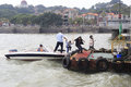 Father took his son s hand from the speedboat to shore in amoy city china Royalty Free Stock Photography