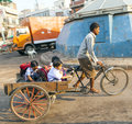 Father transports his children delhi india oct on october in delhi india cycle rickshaws were introduced in to delhi in the s by Royalty Free Stock Photography