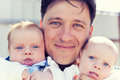 Father with twins Royalty Free Stock Photo