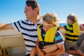 Father and two kid boys enjoying sailing boat trip Royalty Free Stock Photo