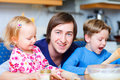 Father with two kids at kitchen Stock Photo