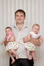 Father with two lovely twins Royalty Free Stock Images