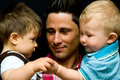 Father with two sons Royalty Free Stock Photo
