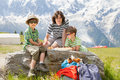 Father and two sons rest in mountain have got picnic Royalty Free Stock Images