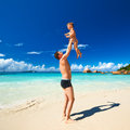 Father and two year old boy playing on beach baby his at seychelles Stock Photos