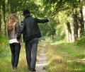 Father walking in the woods with daughter portrait of a Royalty Free Stock Photos