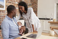 Father Working On Laptop Holds Newborn Son With Mother Royalty Free Stock Photo