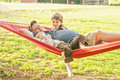 image photo : Father and young sons in hammock