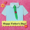 Fathers day card craft background stock photo with yellow happy text blue shirt green tie on red backdrop Royalty Free Stock Photography