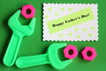 Fathers day card happy fathers day text tools wrench screw nuts green background Stock Image