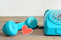 Fathers Day card: Old blue telephone and heart  shaped tag Royalty Free Stock Photo