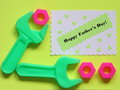 Fathers day card tools background stock photo with happy text and wrench screw nuts on yellow Royalty Free Stock Photos