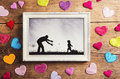 Fathers day composition picture frame and colorful hearts on the floor studio shot on wooden background Stock Photography